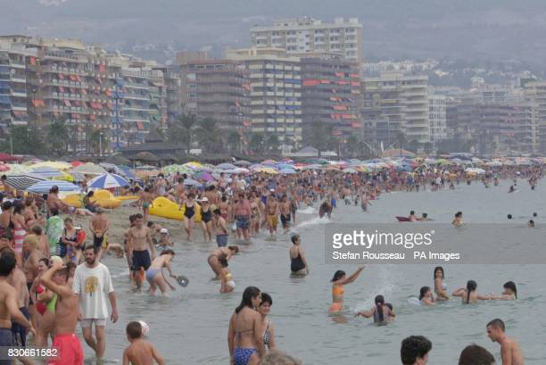 People flock to the beach at Fuengirola on the Costa Del Sol in Spain despite a series of bomb alerts across the country in recent days 12 million...