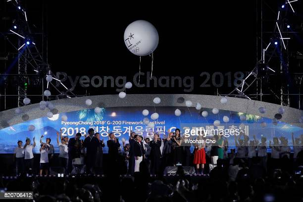People fly ad balloon during the ceremony marking the 200 days to go to the PyeongChang Winter Olympic Games on July 22 2017 in Chuncheon South Korea