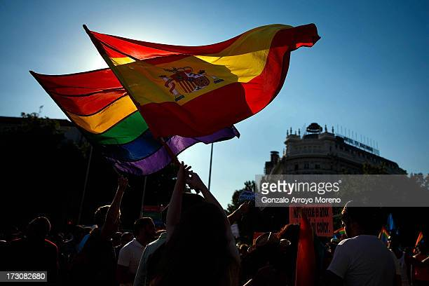 People fly the Spanish and Gay Pride flags at the Madrid Gay Pride Parade 2013 on July 6 2013 in Madrid Spain According to a new Pew Research Center...