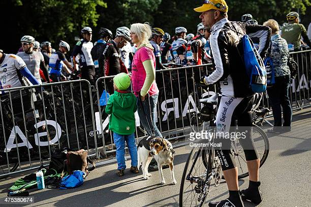People follow as participants ride a bike part at the 8th Garmin Velothon on May 31 2015 in Berlin Germany Ten thousand bike enthusiasts drove routes...