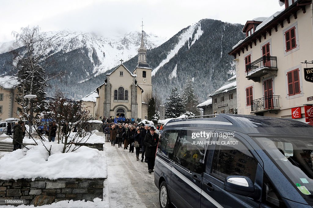 People follow the hearse carrying the coffin of French climber Maurice Herzog after his funeral ceremony, on December 20, 2012 at the Saint-Michel church in Chamonix, French Alps. Maurice Herzog, the French climber who conquered Annapurna in the first recorded ascent of a peak above 8,000 metres, has died at the age of 93, on December 13. AFP PHOTO JEAN-PIERRE CLATOT