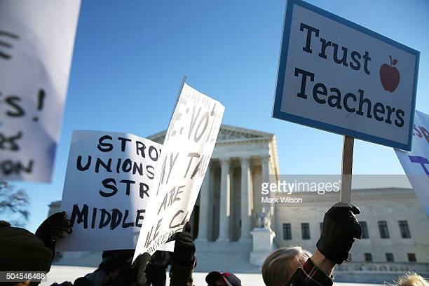 People for and against unions hold up signs in front of the US Supreme Court building January 11 2016 in Washington DC The high court is hearing...