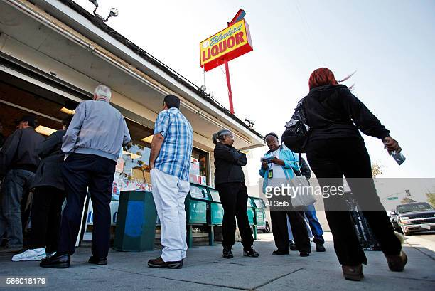 People form a line out the front door at Bluebird Liquor located on Hawthorne Blvd at 137th Street in Hawthorne on Monday April 08 2013 as tickets...