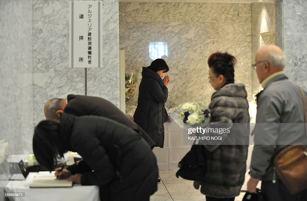 People form a line to offer flowers and condolences for Japanese victims who have been confirmed dead, at the Japanese plant construction company JGC headquarters in Yokohama, suburban Tokyo on January 24, 2013 following the Algerian hostage crisis in In Amenas when jihadists struck on January 16 at the start of a four-day siege that left dozens of foreigners dead. A Japanese government plane will bring home seven Japanese survivors and the bodies of Japanese victims from Algeria on January 25 or later.