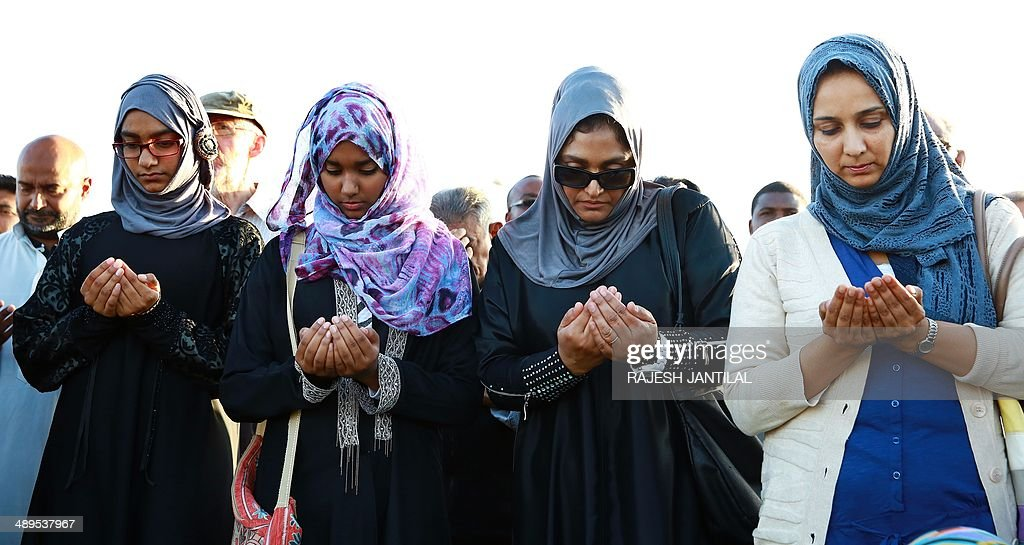 People from all faiths gather to pray for the immediate release of the abducted Nigerian school girls during an interfaith prayer meeting held at the Blue lagoon Beach in Durban on May 11, 2014 .A call from all faiths was for the safe return of the more than 200 girls abducted in Nigeria.