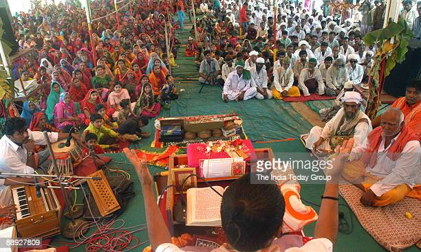 People from both Hindu and Muslim communities sitting at a Sri Bhagwat Katha session for communal harmony held at Dargah Ground in Ahmedabad Gujarat...