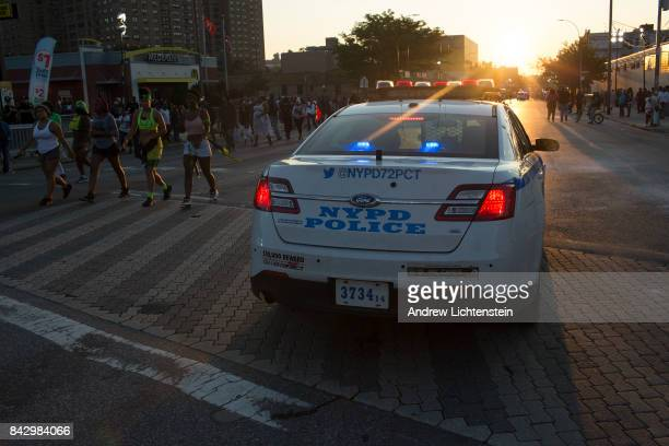 People from Brooklyn's West Indian community march in the Jouvert carnival parade on September 4 2017 in the Crown Heights neighborhood of Brooklyn...
