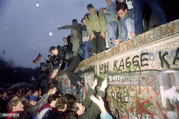 People from East Germany greet citizens of West Germany at the Brandenburg Gate in Berlin on December 22 1989 On November 09 Gunter Schabowski the...