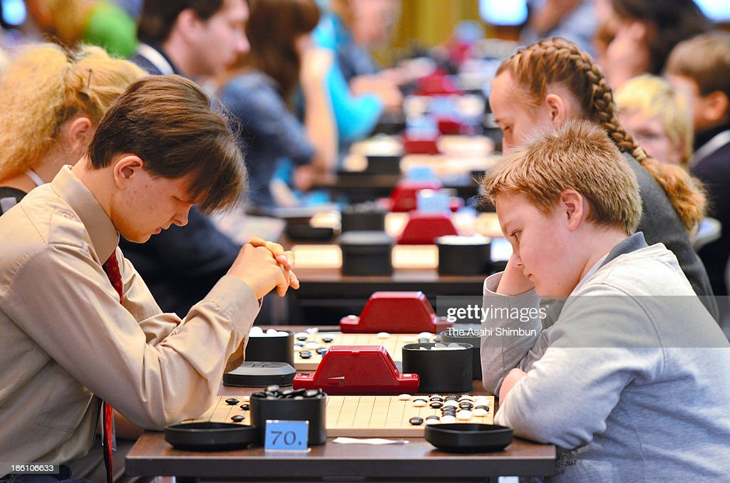 People, from elementary school children to elderly on pension, participate during Russia Go Championship on October 26, 2013 in Moscow, Russia. 'Go' is a kind of chess played with black and white stone pieces.
