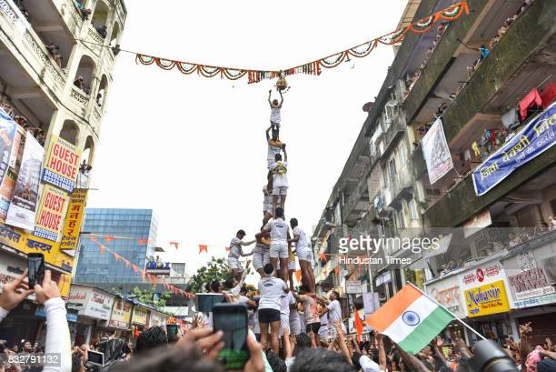 People from Govinda Mandal form human pyramid to break earthen pots on the occasion of Janmashtami at Dadar on August 15 2017 in Mumbai India The...