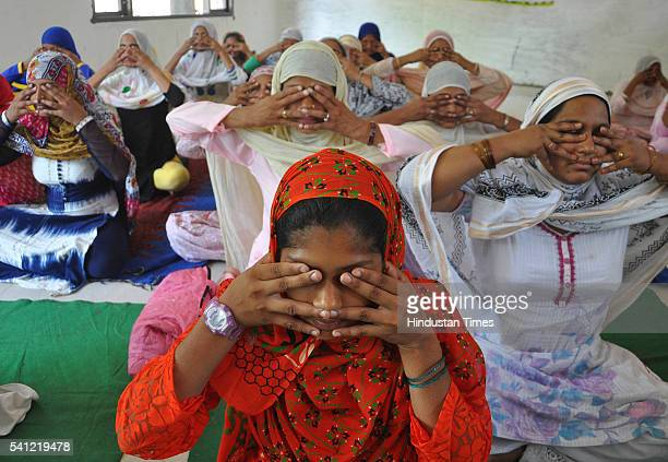 People from Muslims community doing yoga during the rehearsals for the upcoming International Yoga Day at CL Aggarwal DAV school sector 7 on June 19...