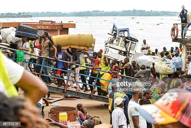 People from the Democratic Republic of Congo disembark as they arrive on an ATC boat from neighboring Congo Brazzaville after being forcefully...