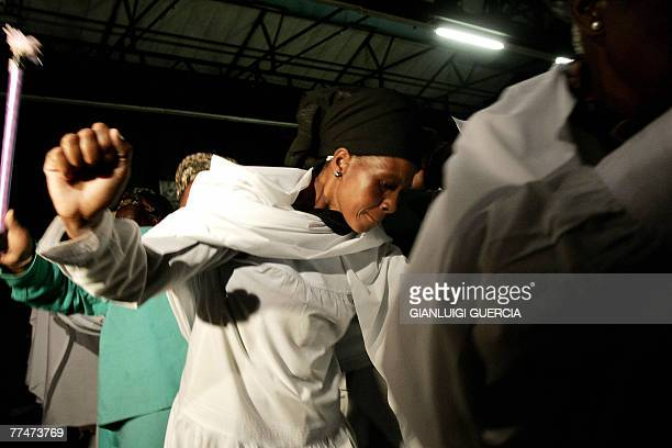 People from the Isaiah Shembe church sing and dance 24 October 2007 during the memorial service for South African reggae musician Lucky Dube murdered...