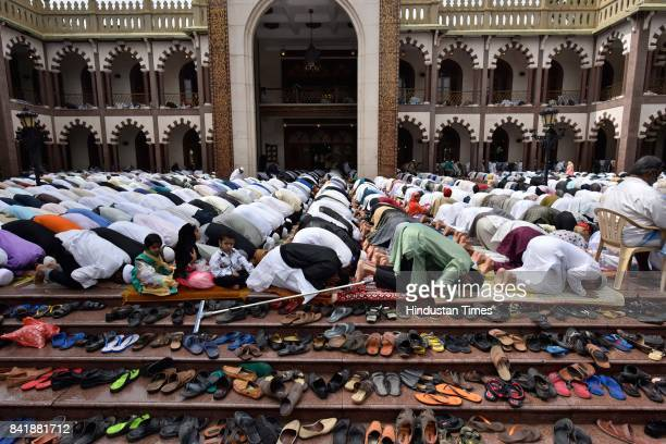 People from the Muslim community offer prayer on the occasion of Eid alAdha the festival of sacrifice at MasjideKhadira on September 2 2017 in...