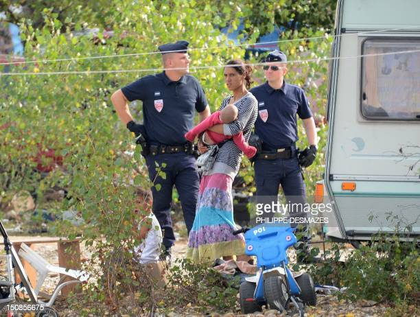 People from the Roma community are expelled from their camp by French police officers on August 28 in SaintPriest outside Lyon centraleastern France...
