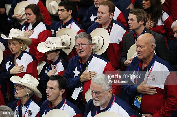 People from the Texas delegation say the Pledge of Allegiance during the second day of the Republican National Convention at the Tampa Bay Times...