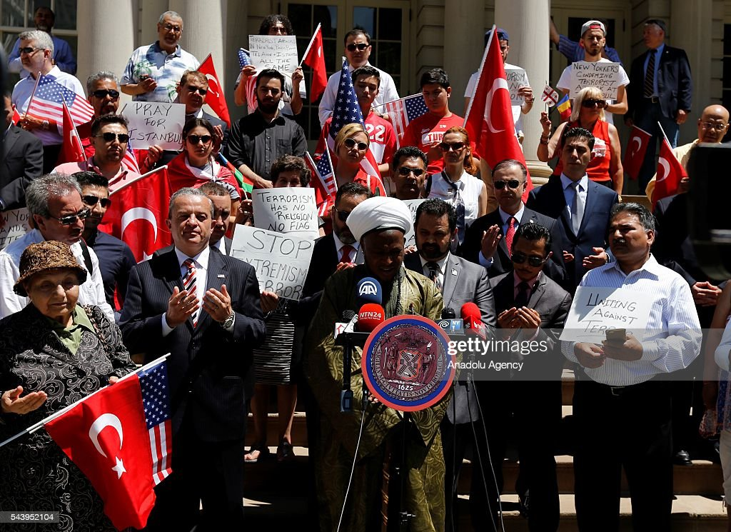 People from varied societies pray during a commemoration ceremony, held for the victims of recent Istanbul Ataturk Airport terrorist attack, in front of the New York City Hall in New York, USA on June 30, 2016. Also, Speaker of the New York City Council, Melissa Mark-Viverito (not seen) gave a speech during the ceremony.