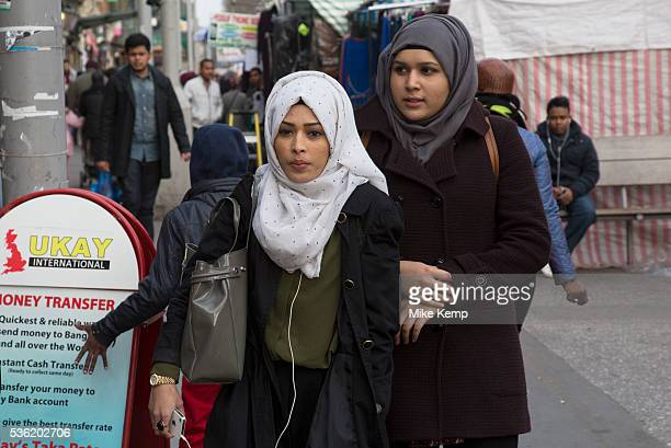 People from various ethnic backgrounds around the market on Whitechapel High Street in East London This area in the Tower Hamlets is predominantly...