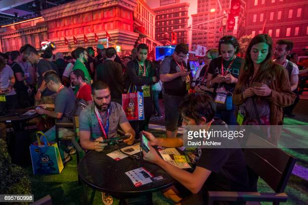 People game in the Nintendo exhibit on opening day of the Electronic Entertainment Expo at the Los Angeles Convention Center on June 13 2017 in Los...
