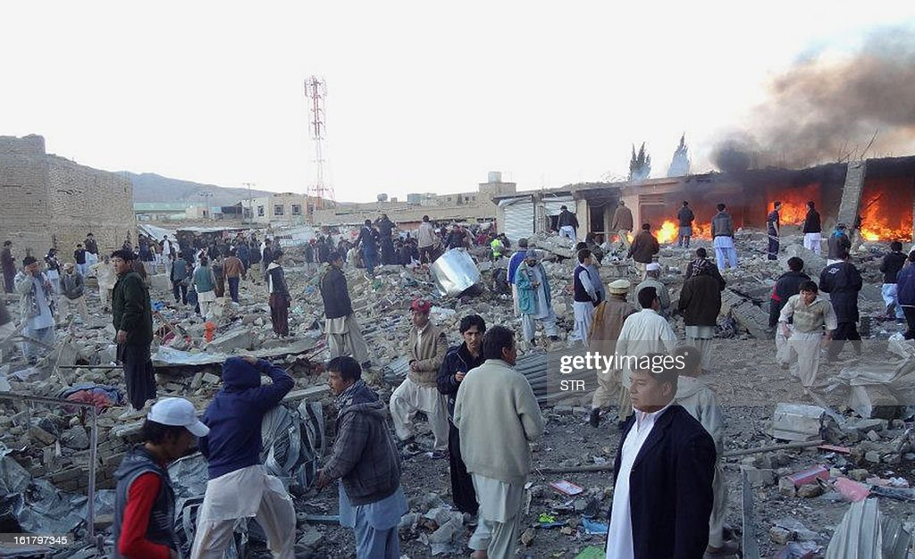 People gather after a bomb targeting Shiite Muslims exploded in busy market in Hazara town, an area dominated by Shiites on the outskirts of Quetta, on February 16, 2013. The bomb killed 63 people including women and children and wounded 180 in Pakistan's insurgency-hit southwest, police and officials said.