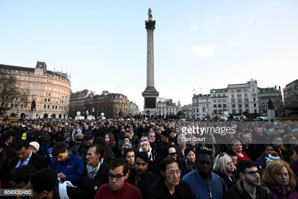 People gather ahead of a candlelit vigil at Trafalgar Square on March 23 2017 in London England Four People were killed in Westminster London...