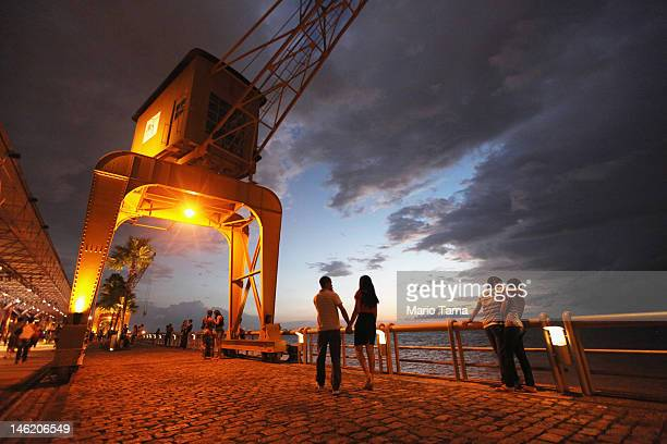 People gather along the water at a former riverside port converted into an entertainment complex on June 7 2012 in Belem Brazil Belem is considered...