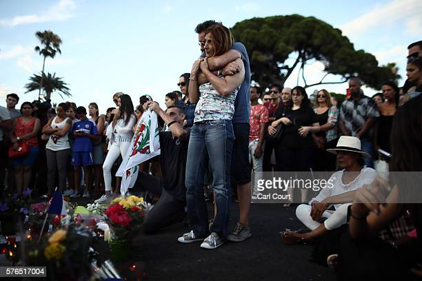 People gather and lay tributes on the Promenade des Anglais on July 15 2016 in Nice France A FrenchTunisian attacker killed 84 people as he drove a...