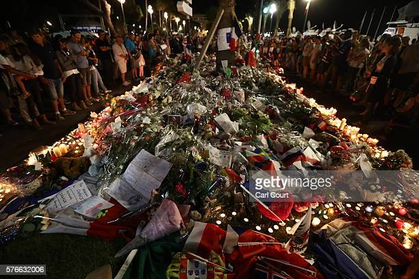 People gather and lay tributes on the Promenade des Anglais on July 16 2016 in Nice France Five people believed to be linked to the man who killed 84...