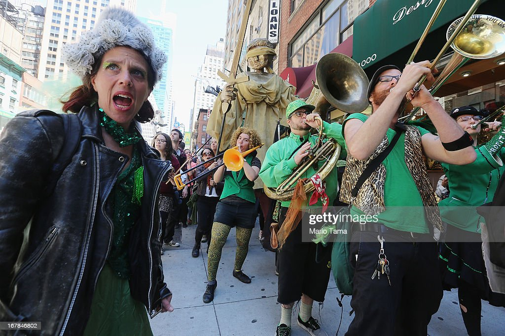 People gather and perform during a march for immigrant worker rights as part of May Day rallies on May 1, 2013 in New York City. Rallies and marches are occuring throughout the city today to mark the day which is traditionally associated with workers movements.