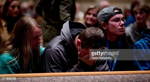 People gather and pray at Center Point Church following a mass shooting on February 21 2016 in Kalamazoo Michigan Authorities said that a shooter who...