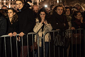 People gather and pray outside of Notre Dame Cathedral ahead of a ceremony to the victims of the Friday's terrorist attacks on November 15 2015 in...
