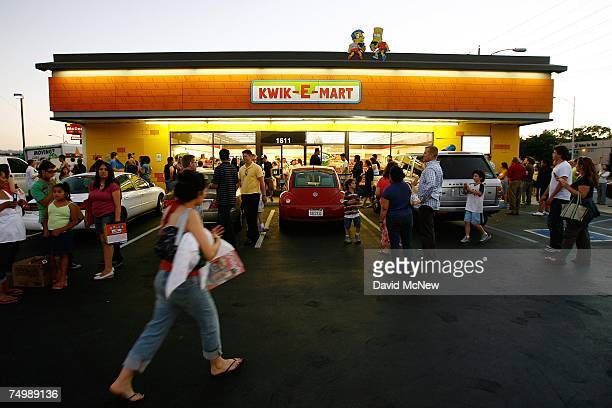 People gather around a 711 convenience store converted into a 'KwikEMart' store from the longrunning television cartoon show 'The Simpsons' to...