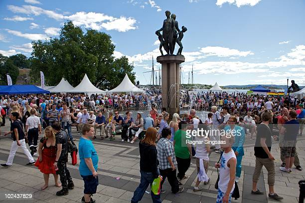 People gather around a fountain outside Oslo City Hall during the Gay Pride Festival on June 26 2010 in Oslo Norway