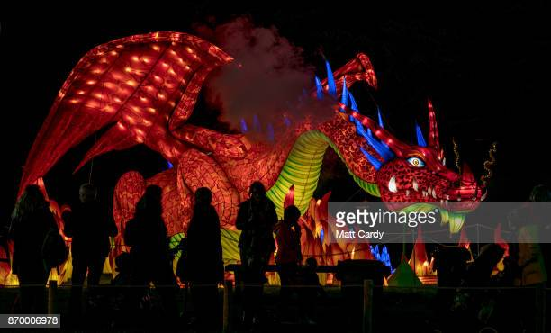 People gather around a illuminated dragon as they enjoy the spectacle at the opening night of annual Festival of Light at the Elizabethan Longleat...