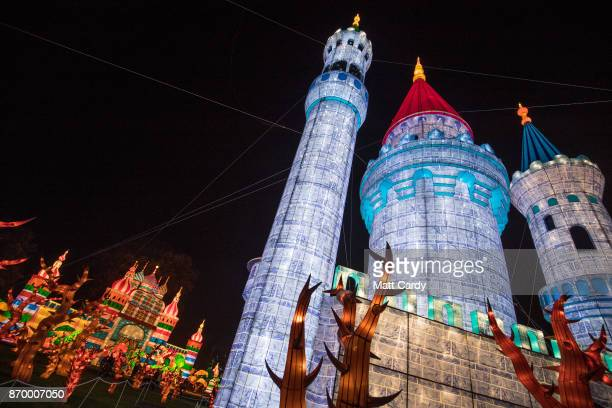 People gather around a illuminated Rapunzel tower as they enjoy the spectacle at the opening night of annual Festival of Light at the Elizabethan...