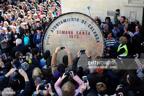 People gather around a large bass drum used to signal the start of festivities during Holy Week celebrations on March 25 2016 in Calanda Spain