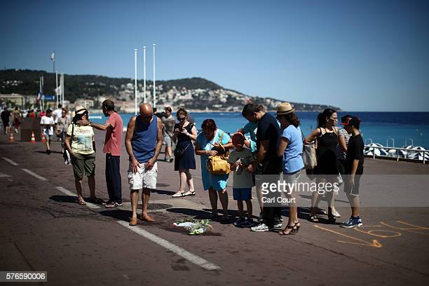 People gather around a spot where a person was killed on the Promenade des Anglais on July 16 2016 in Nice France Five people believed to be linked...