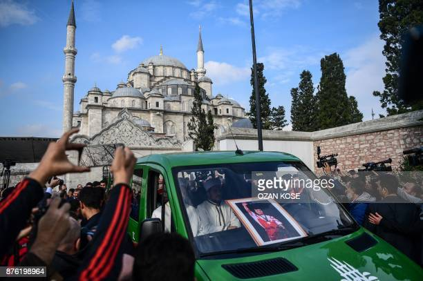 People gather around the hearse carrying the coffin of Turkey's legendary triple Olympic goldmedal winning weightlifter Naim Suleymanoglu during his...