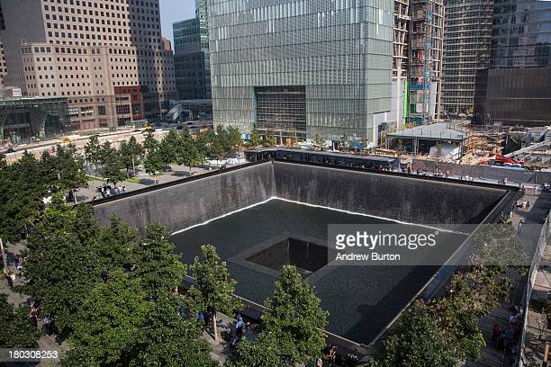 People gather around the NorthTower pool during memorial ceremonies for the twelfth anniversary of the terrorist attacks on lower Manhattan at the...