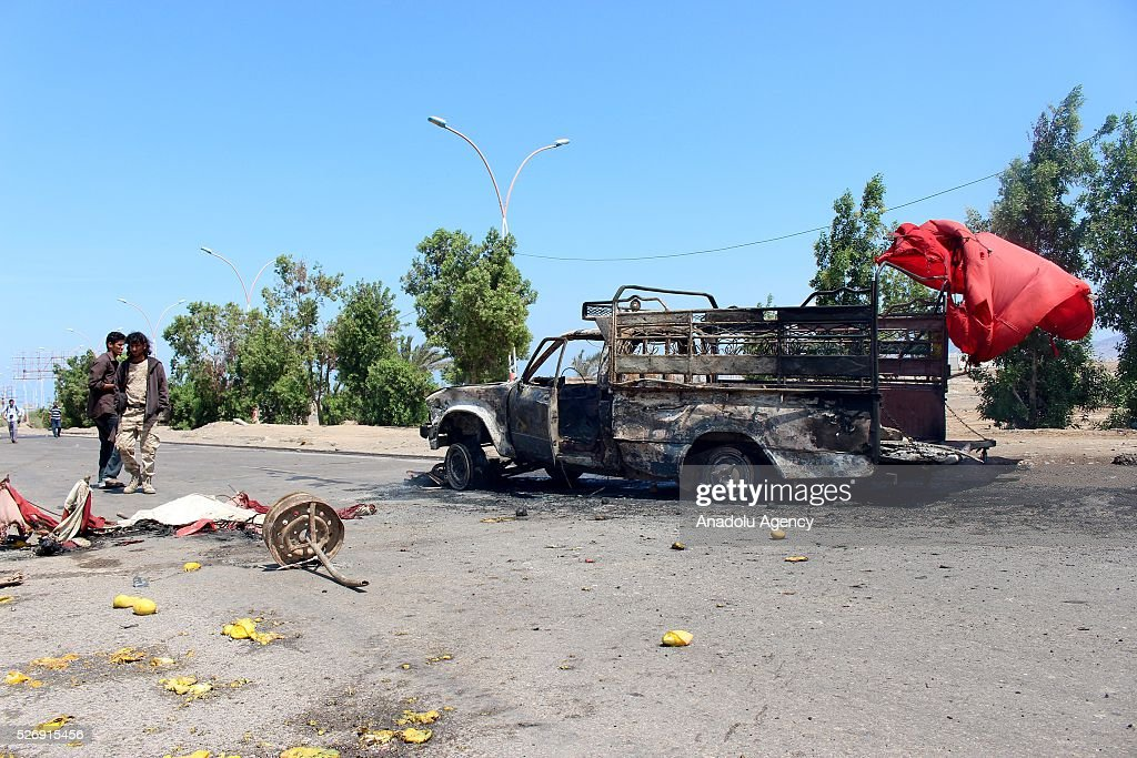 People gather around the scene of a blast after unidentified gunmen staged an attack to the convoy of Aden Chief of Police at the Al-Mansoura region in Aden, Yemen on May 1, 2016.
