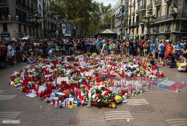 People gather around tributes on Las Ramblas near the scene of Thursday's terrorist attack on August 19 2017 in Barcelona Spain A nationwide manhunt...
