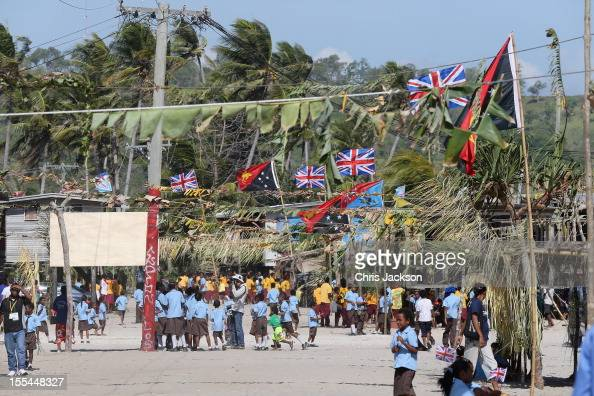 People gather as Camilla Duchess of Cornwall and Prince Charles Prince of Wales visit Borea Village on November 4 2012 in Port Moresby Papua New...