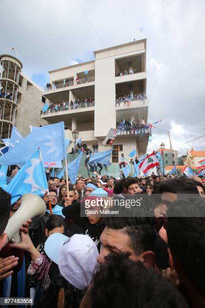 People gather as Lebanon's Prime Minister Saad Hariri makes a public appearance at his home 'Beit alWasat' November 22 2017 in Beirut Lebanon Hariri...