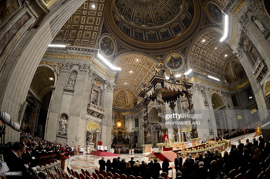 People gather as Pope Benedict XVI celebrates the Vespers and Te Deum prayers in Saint Peter's Basilica the mark the end of 2012 at the Vatican on December 31, 2012. AFP PHOTO / ANDREAS SOLARO