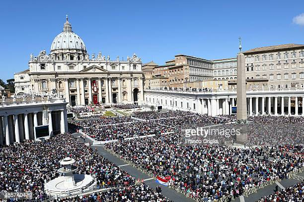 People gather as Pope Francis holds Easter Mass in St Peter's Square on April 20 2014 in Vatican City Vatican Pope Francis is attending the Holy Week...