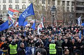 People gather as Serbian Radical Party ultranationalist leader Vojislav Seselj gives a speech during a antigovernment demonstration protesting ICTY's...