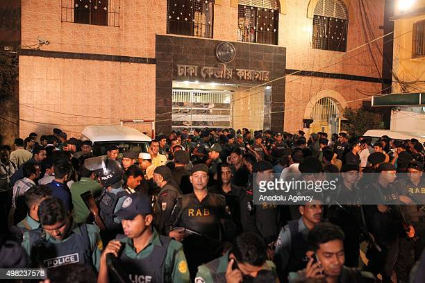 People gather as they wait the Ambulances carrying dead bodies of Salahuddin Quader Chowdhury and Ali Ahsan Muhammad Mojaheed in front of he jail in...