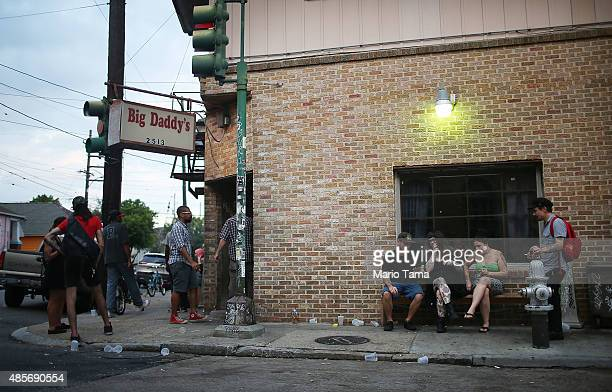 People gather at a bar after sunrise on August 29 2015 in New Orleans Louisiana Today is the 10th anniversary of Hurricane Katrina which flooded 80...