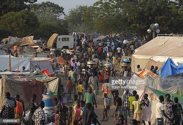 People gather at a makeshift IDP camp at the United Nations Mission in South Sudan compound in Juba on December 22 2013 where South Sudanese continue...