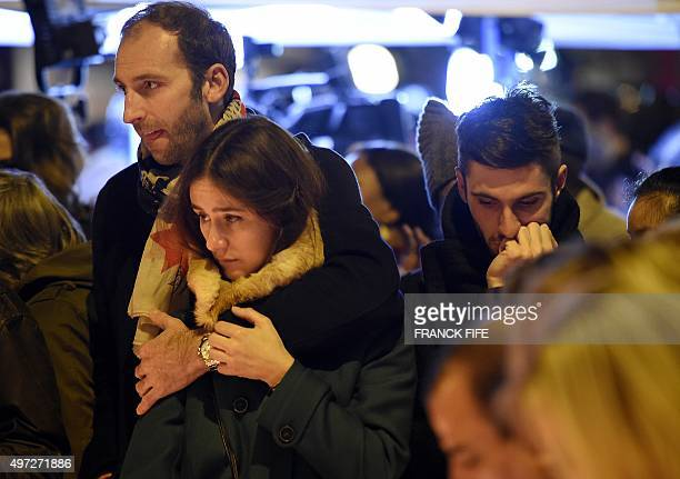 People gather at a makeshift memorial in front of the Bataclan theatre one of the site of the attacks in Paris on November 15 in Paris Islamic State...
